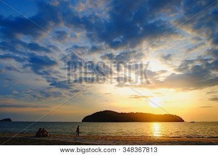 People Relaxing On Paradise Beach. Pantai Tengah Beach At Colorful Sunset, Langkawi Island, Malaysia