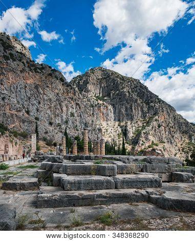 Temple Of Apollo And Serpent Column Of Plataea In Delphi, Greece. Summer Scenic Landscape With Ancie