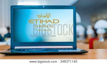 Poznan, Pol - Dec 11, 2019: Laptop Computer Displaying Logo Of Etihad Airways Headquartered In Khali