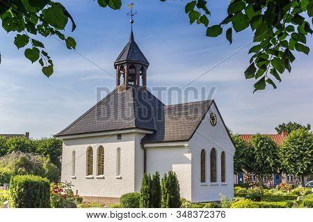 Little White Chapel In Holm Village Of Schleswig, Germany