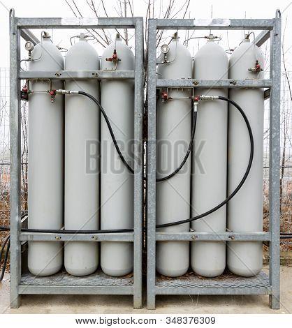 Grey Seamless Steel Industrial Gas Cylinders. Pressurized Cylinder. Industrial Stainless Steel Bottl