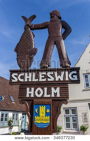 Schleswig, Germany - June 25, 2019: Wooden Sign At The Entrance Of Historic Holm Village In Schleswi