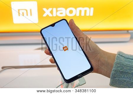 Minsk, Belarus - January 29, 2020: Smartphone With Xiaomi Logo On Screen In Hand. Customer Choosing