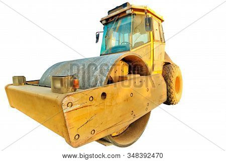 Closeup Of Steamroller Isolated On White Background With Copy Space. Concept Of Work In Progress.