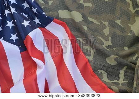 United States Of America Flag And Folded Military Uniform Jacket. Military Symbols Conceptual Backgr