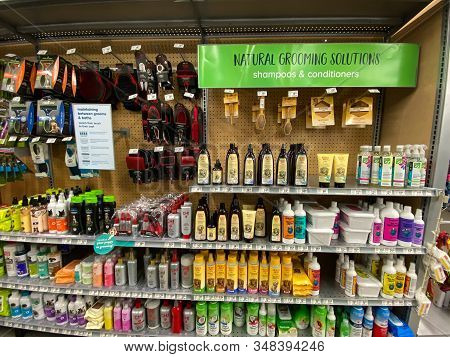 Orlando, Fl/usa-1/28/20: Dog Grooming Products In A Petsmart Pet Superstore With Its Owner Picking O