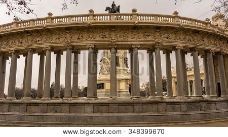 Views Of The Monument To Alfonso Xii In The Retiro Park, On A Cloudy Day In Madrid. Travel Concept