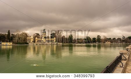 Impressive View Of The Alfonso Xii Monument In Retiro Park On A Cloudy Winter Day In Madrid. Travel