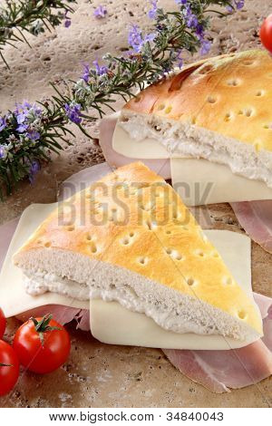 panfocaccia with cream of mushroom and ham on the stone table poster