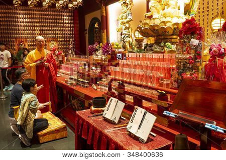 Singapore. January 2020.  The Faithful Pray In Buddha Tooth Relic Temple