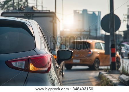 Transportation Of Luxury Car Open Turn Right Signal Prepare For U-turn In The City.