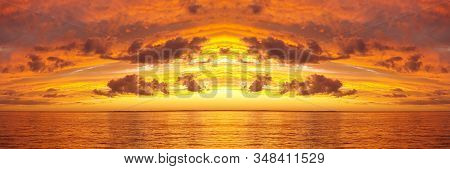 Beautiful Orange And Gold Coloured Cirrus And Cumulus Cloudy Coastal Sunset Seascape Panorama Over