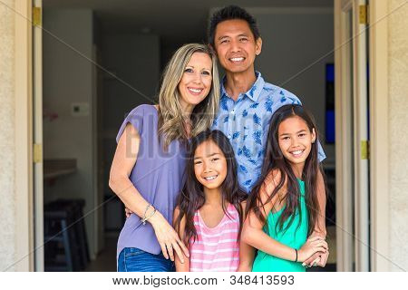Portrait Of A Happy Mixed Race Family.