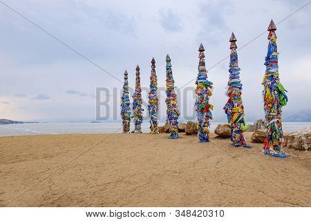 Shamanistic Wooden Ritual Totems With Colorful Ribbons At Cape Burhan, Baikal, Olkhon Island, Siberi