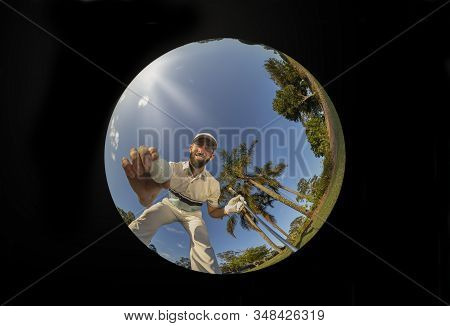 Golf Hole Point Of View Of Smiling Golfer In White Attire, Picking His Ball Out Of A Hole, After A H
