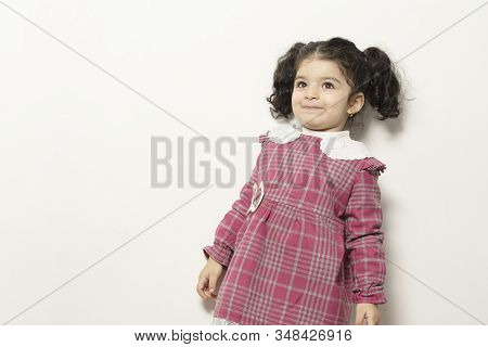 Little Girl With Two Parts Side Pony Hairstyle With Happy Expression, Childhood Memories Concept