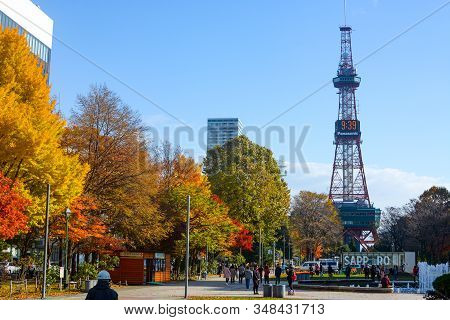 Sapporo, Japan - October 31, 2019: Crowds Enjoy Sunshine On A Chilly Autumn Day In Front Of The Sapp