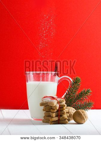 Beautiful Composition With Christmas Cookies And Milk For Santa