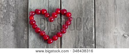 Cherry Heart Shape On A Wooden Rustic Background. Fresh Berries On Weathered Wooden Table. Social Me