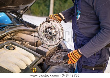 Car Mechanic Is Changing Clutch. Hands Car Mechanic!