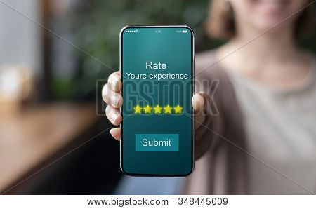 Smiling Woman Hand Holding Modern Phone With 5 Star Rating Experience, Live Photo, Copy Space, Blurr