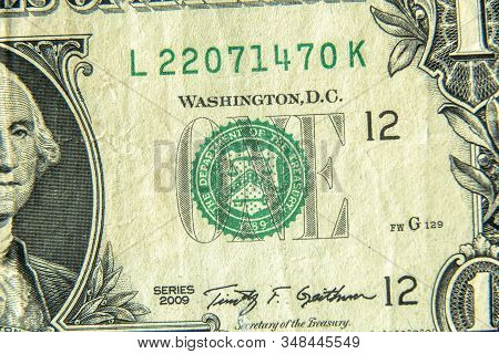 Dollar Bill Close Up. Detail Of Us One Dollar Banknote With Green Seal Symbol. Macro View Of Single