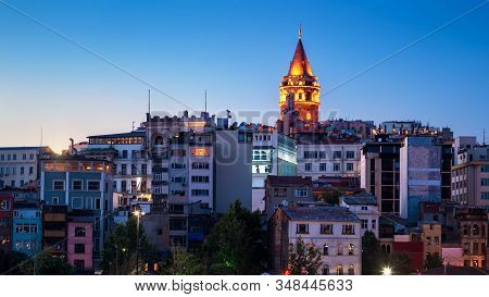 Galata Tower At Night, Istanbul, Turkey. Medieval Galata Tower Is A Famous Landmark Of Istanbul City