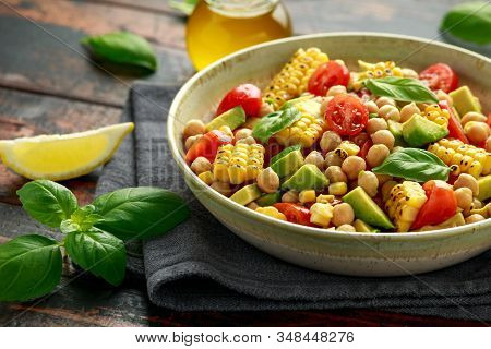 Avocado Chickpea Salad With Grilled Sweet Corn, Tomato And Basil. Healthy Vegan Food
