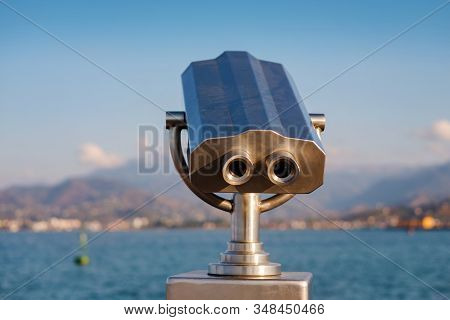 Public Stationary Binocular On Sea Shore, Coin Operated Metal Binocular Viewer On Blurred Background