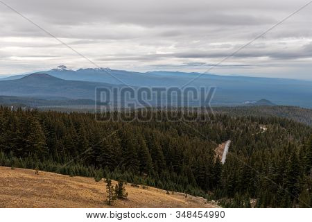 Road Through Pine Forest Seen From Crater Lake, Oregon, Usa