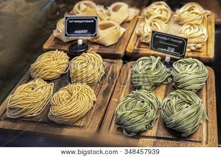 Closeup Of Raw Fresh Homemade Green Pasta Tagliatelle. Fresh Italian Traditional Raw Pasta On The Co