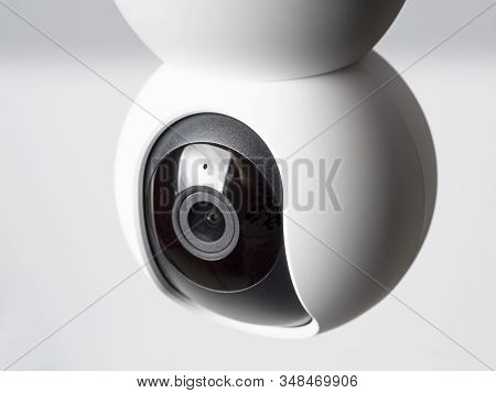 Close-up Wireless Surveillance Camera Isolated On White Background, A Concept Of A Home Surveillance