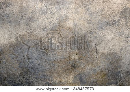 Concrete Gray Texture Background. Cracked Cement Wall Of Heterogeneous Color.