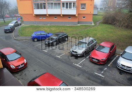 Chomutov, Czech Republic - January 18, 2020: Cars On Parking Place Between Houses In Centre Of City