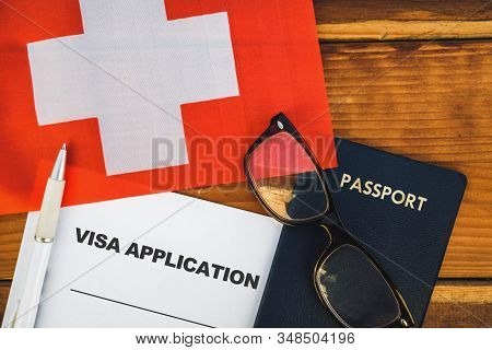 Flag Of Switzerland , Visa Application Form And Passport On Table