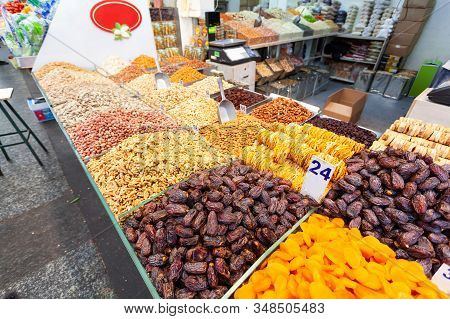 Dried Fruits And Nuts, Beautifully Laid Out On A Counter In A Small Shop In The Mahane Yehuda Market