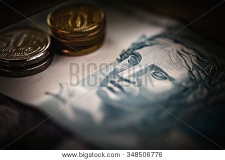 Brazilian Money In Close Up. One Hundred Reais Bill And Brazilian Coins, Concept Of Savings Or Savin