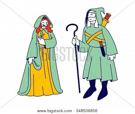 Medieval Characters Man And Woman Wearing Ancient Long Dress With Hood On Head. Male Personage Holdi