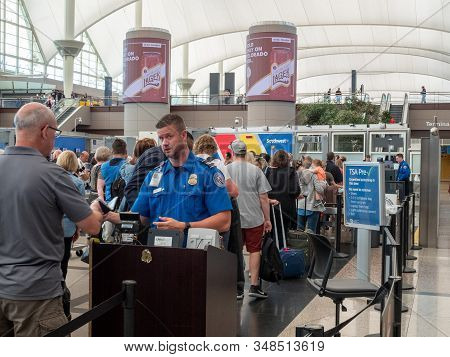 Denver, Co July 7, 2018: Tsa Agent Passes Man Through Security Checkpoint At Denver International Ai