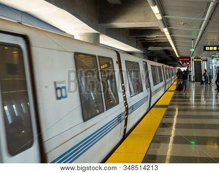 San Francisco, Ca July 17, 2018: Bart Bay Area Rapid Transit Train With Passengers Ready To Board