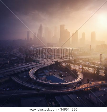 Los Angeles downtown silhouette at foggy sunrise. LAX most famous city of california. Typical view of the Los Angeles.
