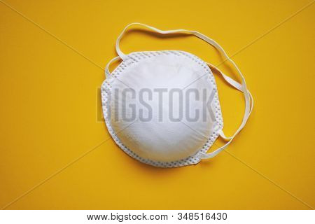 Face Mask Or Dust Mask Or Filtering Facepiece Respirator - Breathing Protection Against Air Pollutio