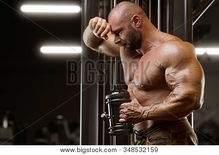 Bodybuilder Drinking Water After Fitness Workout