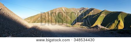 Tian Shan Mountains In Kyrgyzstan And Unpaved Road, Panoramic View Of Steppe Kyrgyz Mountains.