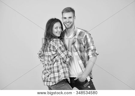 Sorry Girls This Man Is Taken. Happy Couple Yellow Background. Couple In Love. Sensual Couple Hug In
