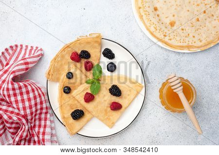 French Crepes With Berries Folded On Plate. Top View. Blini, Crepes With Honey