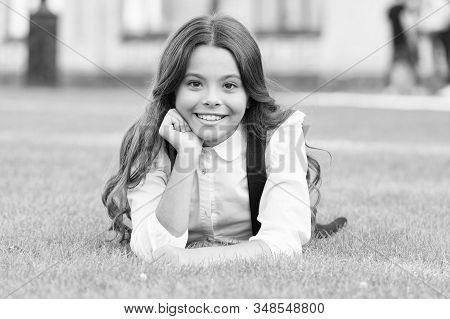Mental Wellness. Little Schoolgirl. Relax At School Yard. Kid Relaxing Outdoors. School Break For Re