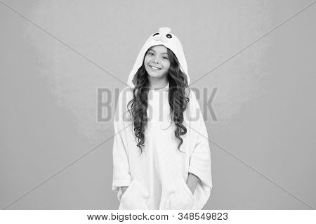 Adorable Pajamas. Little Girl Small Child Wearing Cute Pajamas With Hood. Feeling Cozy And Comfortab
