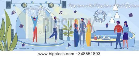 Guests In Restaurant Watching Stage Performance During Christmas Or New Year Party Celebration. Wome