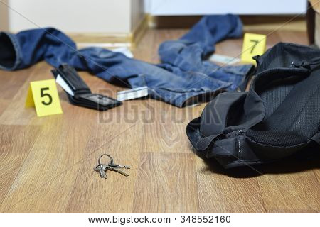 Crime Scene Investigation - Numbering Of Evidences After The Murder In The Apartment. Keys, Wallet A